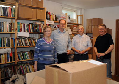 A merry AFU gang unpacking books from the UK in June 2012: Katarina Hampusson, Clas Svahn, Carl-Anton Mattsson and Anders Liljegren